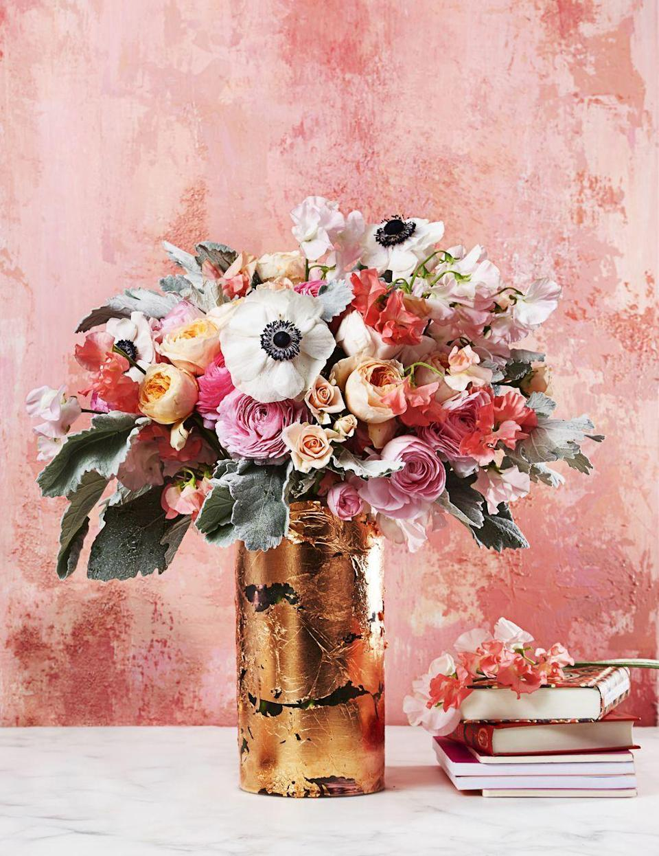 """<p>Bring the elegance to your Easter affair with this gilded decoration. In small sections, paint on an adhesive, then lay metallic sheets on glass and smooth. Fill with a pretty mix of peach garden roses, blush ranunculus, pink sweet peas, lamb's ears, and white anemones. </p><p><a class=""""link rapid-noclick-resp"""" href=""""https://www.amazon.com/Bememo-Imitation-Gilding-Crafting-Decoration/dp/B0722X91YR/?tag=syn-yahoo-20&ascsubtag=%5Bartid%7C10055.g.1906%5Bsrc%7Cyahoo-us"""" rel=""""nofollow noopener"""" target=""""_blank"""" data-ylk=""""slk:SHOP GOLD LEAF"""">SHOP GOLD LEAF</a></p>"""