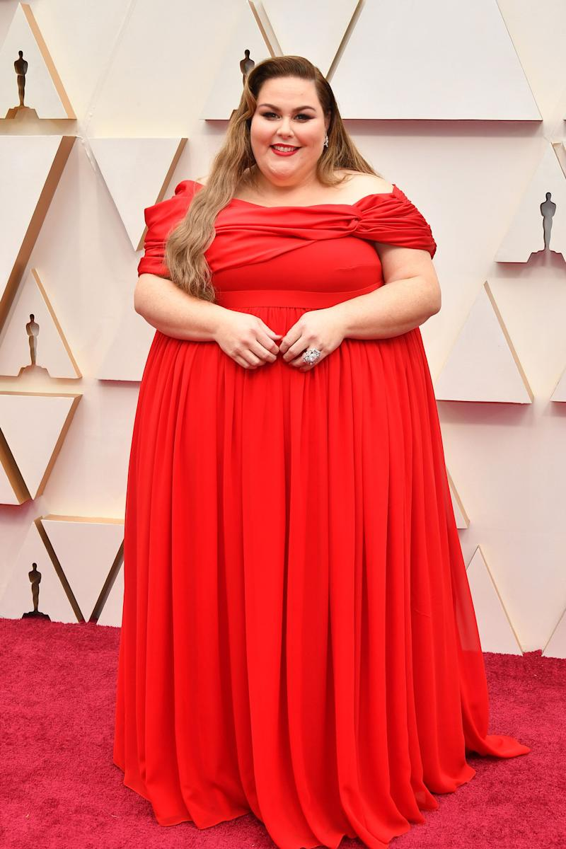 The colour feels a <i>liiiiiitle</i> on the nose for a red carpet, but that draping is beautiful.