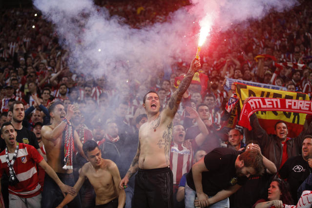 Atletico fans celebrate the 3-0 win of their team after the Europa League Final soccer match between Marseille and Atletico Madrid at the Stade de Lyon in Decines, outside Lyon, France, Wednesday, May 16, 2018. (AP Photo/Francois Mori)