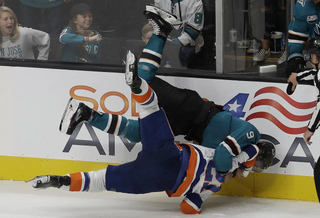 San Jose Sharks left wing Evander Kane, top, fights with New York Islanders left wing Anders Lee during the third period of an NHL hockey game in San Jose, Calif., Saturday, Oct. 20, 2018. The Sharks won 4-1. (AP Photo/Jeff Chiu)