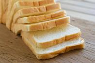 """<p>Whether you <a href=""""https://www.thedailymeal.com/how-to-bake-bread-at-home?referrer=yahoo&category=beauty_food&include_utm=1&utm_medium=referral&utm_source=yahoo&utm_campaign=feed"""" rel=""""nofollow noopener"""" target=""""_blank"""" data-ylk=""""slk:make your own bread"""" class=""""link rapid-noclick-resp"""">make your own bread</a> or grab a loaf from the grocery store, everyone should know when to keep and when to toss this culinary staple. <a href=""""https://www.thedailymeal.com/eat/how-long-does-bread-last?referrer=yahoo&category=beauty_food&include_utm=1&utm_medium=referral&utm_source=yahoo&utm_campaign=feed"""" rel=""""nofollow noopener"""" target=""""_blank"""" data-ylk=""""slk:Grocery store bread is good for five to seven days"""" class=""""link rapid-noclick-resp"""">Grocery store bread is good for five to seven days</a> after opening, but it can be consumed after that as long as there is no mold growth or it doesn't get crusty and stale. You can usually spot fuzzy, green growth on bread, so it's easy to tell when it's time to toss. Porous foods like bread can be contaminated with mold below the surface, which means you shouldn't just cut out the moldy spot and continue eating it. You can always <a href=""""https://www.thedailymeal.com/cook/how-to-freeze-thaw-bread?referrer=yahoo&category=beauty_food&include_utm=1&utm_medium=referral&utm_source=yahoo&utm_campaign=feed"""" rel=""""nofollow noopener"""" target=""""_blank"""" data-ylk=""""slk:freeze bread"""" class=""""link rapid-noclick-resp"""">freeze bread</a> or whip up these <a href=""""https://www.thedailymeal.com/cook/recipes-finish-bread-loaf?referrer=yahoo&category=beauty_food&include_utm=1&utm_medium=referral&utm_source=yahoo&utm_campaign=feed"""" rel=""""nofollow noopener"""" target=""""_blank"""" data-ylk=""""slk:recipes to help you finish off a loaf of bread"""" class=""""link rapid-noclick-resp"""">recipes to help you finish off a loaf of bread</a> before it goes bad.</p>"""