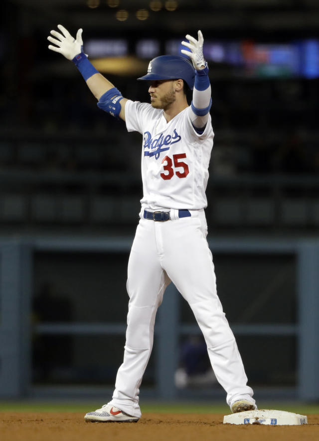 Los Angeles Dodgers' Cody Bellinger raises his arms in celebration after driving in a run with a double against the New York Mets during the ninth inning of a baseball game Wednesday, May 29, 2019, in Los Angeles. (AP Photo/Marcio Jose Sanchez)