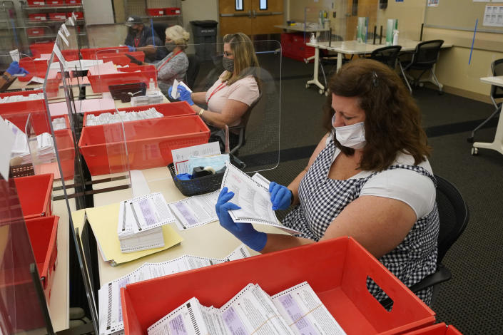 Election workers inspect ballots for damage that have been received for the Sept. 14, recall election at the Sacramento County Registrar of Voters office in Sacramento, Calif., Monday, Aug. 30, 2021. California voters have until Sept. 14 to cast their ballots to either keep Gov. Gavin Newsom in office are replace him with one of over 40 candidates on the recall ballot. In a state dominated by Democrats the outcome will depend on who takes the time to vote. (AP Photo/Rich Pedroncelli)