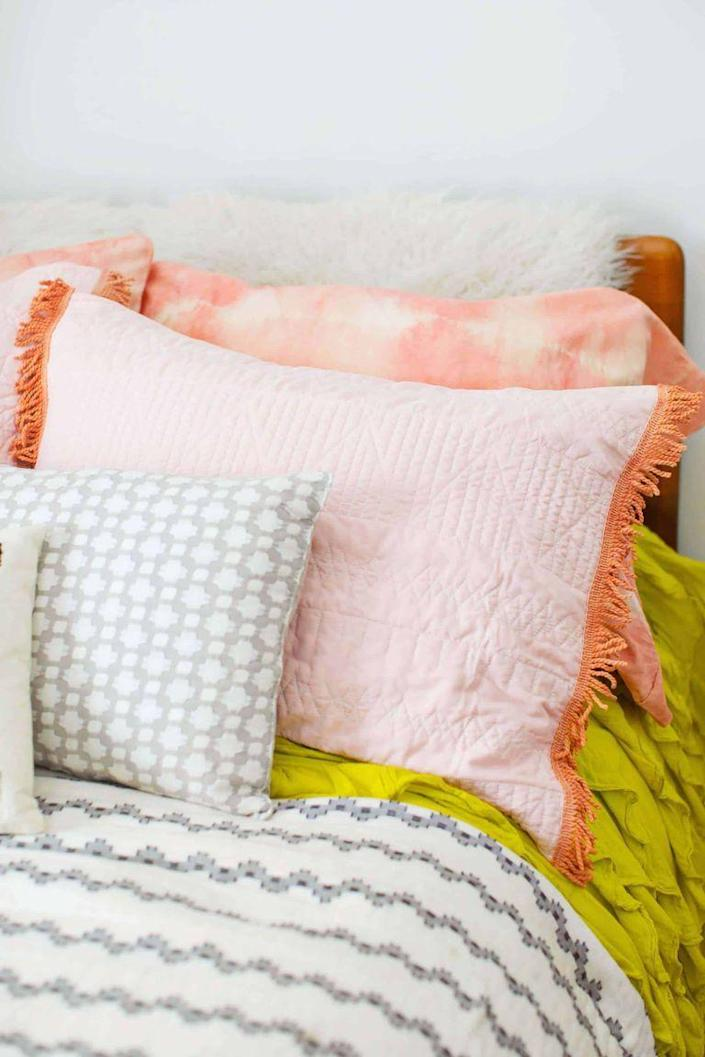 """<p>Beauty sleep just got a whole lot more, well, beautiful. Give her bed a makeover with this easy tutorial.</p><p><strong>Get the tutorial at <a href=""""https://abeautifulmess.com/2017/11/naturally-dyed-pillowcase-diy.html"""" rel=""""nofollow noopener"""" target=""""_blank"""" data-ylk=""""slk:A Beautiful Mess"""" class=""""link rapid-noclick-resp"""">A Beautiful Mess</a>.</strong></p><p><strong><a class=""""link rapid-noclick-resp"""" href=""""https://go.redirectingat.com?id=74968X1596630&url=https%3A%2F%2Fwww.walmart.com%2Fip%2FPiccocasa-1800-Series-Microfiber-2-Piece-Queen-Pillowcase-White%2F823115932%3FvariantFieldId%3Dactual_color&sref=https%3A%2F%2Fwww.thepioneerwoman.com%2Fholidays-celebrations%2Fgifts%2Fg32307619%2Fdiy-gifts-for-mom%2F"""" rel=""""nofollow noopener"""" target=""""_blank"""" data-ylk=""""slk:SHOP PILLOW CASES"""">SHOP PILLOW CASES</a><br></strong></p>"""