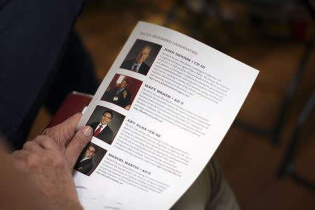 """A flyer listing endorsed candidates is distributed at a meeting of so-called """"Liberty Kids"""" libertarian Republican activists in Burbank, California, July 27, 2014. REUTERS/David McNew"""