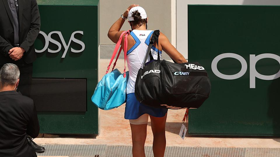 Ash Barty, pictured here leaving the court after retiring hurt against Magda Linette.