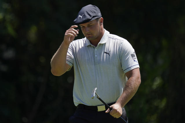 Bryson DeChambeau tips his cap after an eagle on the 11th hole during the third round of the Charles Schwab Challenge golf tournament at the Colonial Country Club in Fort Worth, Texas, Saturday, June 13, 2020. (AP Photo/David J. Phillip)