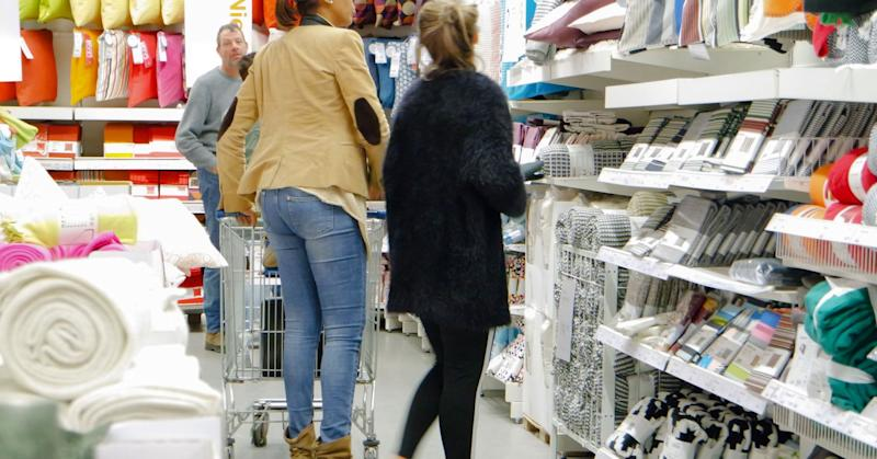 Women browsing the textiles section of Ikea.