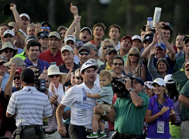 Bubba Watson carries his son Caleb after winning the Masters golf tournament Sunday, April 13, 2014, in Augusta, Ga. (AP Photo/Chris Carlson)