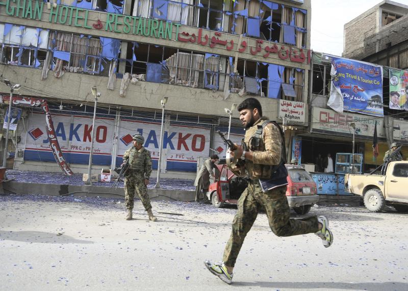 Afghan police officers arrive to the scene after a multi-pronged attack on a police station in Jalalabad, the capital of eastern Nangarhar province, Afghanistan, Thursday, March 20, 2014. Taliban insurgents staged the attack, using a suicide bomber and gunmen to lay siege to the station, government officials said. Two remotely detonated bombs also exploded nearby. (AP Photo/Rahmat Gul)