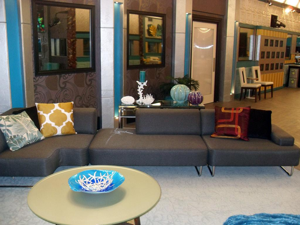"Welcome to the ""<a href=""/big-brother-12/show/45217"">Big Brother</a>"" house! With pops of turquoise and gold, this season's pad is bright, bold, and a lot more festive than last year's. Notice the nautical-themed accessories, the front door (where Houseguests will enter and exit only once), and the massive cameras mounted on the walls. Remember, Big Brother is always watching!"