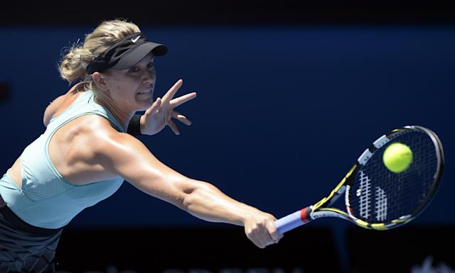 Eugenie Bouchard of Canada plays a shot to Ana Ivanovic of Serbia during their quarterfinal at the Australian Open tennis championship in Melbourne, Australia, Tuesday, Jan. 21, 2014.(AP Photo/Andrew Brownbill)