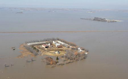File Photo: Aerial view of farmyards surrounded by water during spring flooding of the Red River near Morris