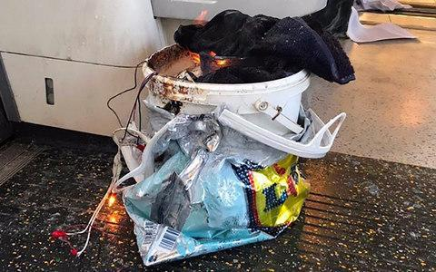 <span>The improvised explosive device in a white bucket blew up on the final carriage of the Parsons Green train</span> <span>Credit: Pricey1983aa/Twitter </span>