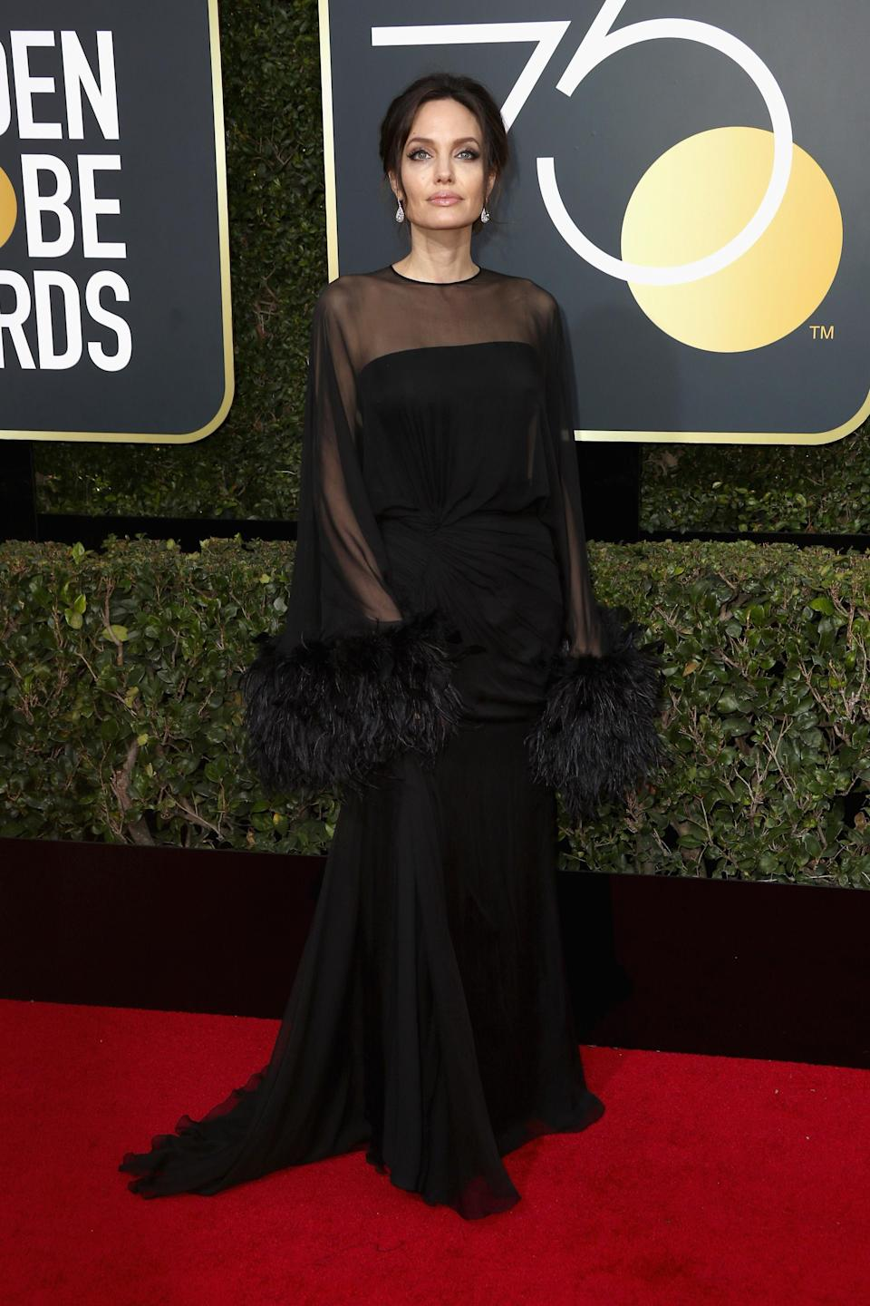 <p>For the 2018 Golden Globe Awards back in January, Angelina Jolie kick-started the year right in a sheer Atelier Versace gown and Barollo Italy shoes. A matching Stuart Weitzman clutch finished the ensemble. <em>[Photo: Getty]</em> </p>