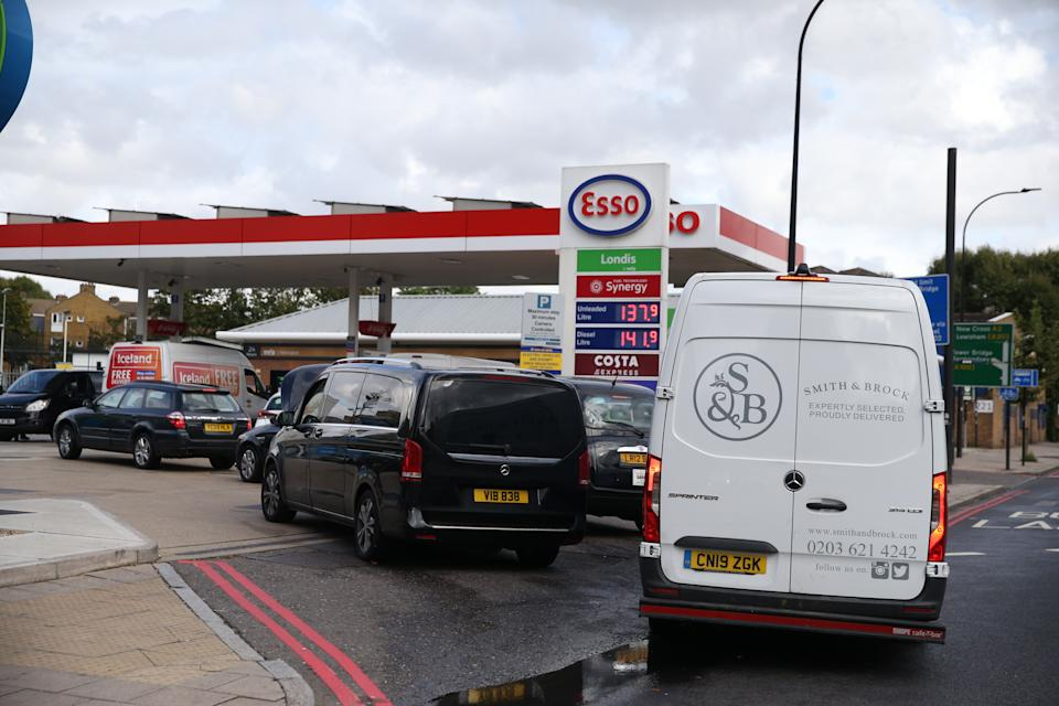 LONDON, ENGLAND - SEPTEMBER 28:Cars queue for fuel at a petrol station in London, United Kingdom on September 28, 2021. The UK has seen long queues formed in front of gas stations after the oil and petrol giant BP and Tesco Alliance announced that a