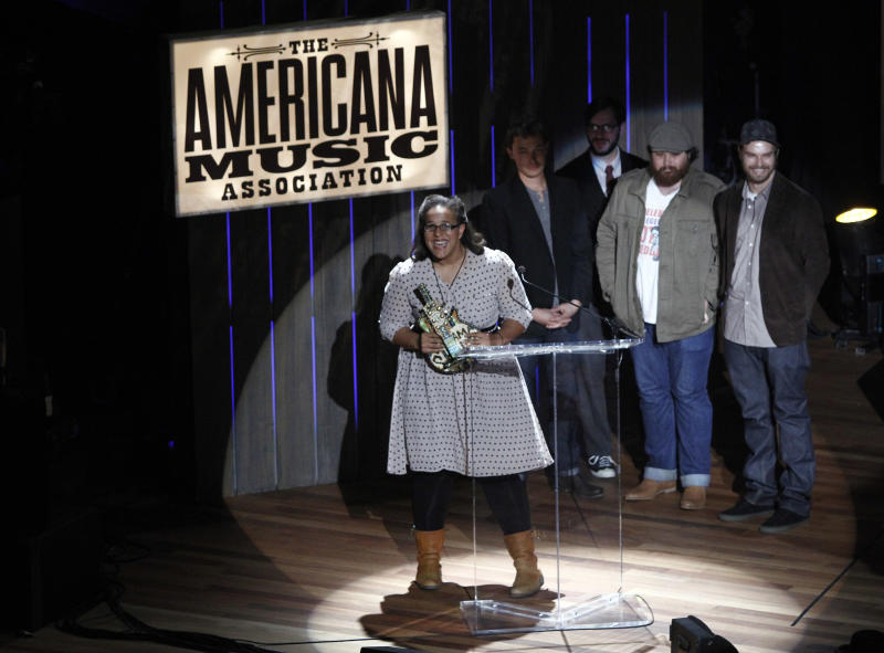 Alabama Shakes members Brittany Howard, guitarist Heath Fogg, bassist Zac Cockrell, and drummer Steve Johnson receive the award for Emerging Artist at the 11th annual Americana Honors & Awards, Wednesday Sept. 12, 2012, in Nashville, Tenn. (Photo by Wade Payne/Invision/AP)