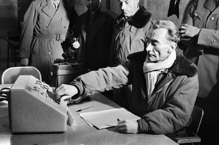 French General Jean Thiry presses the button which triggers the third French nuclear test explosion in the Algerian Sahara in 1960