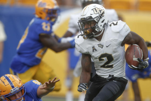 Central Florida' Otis Anderson (2) gets past Pittsburgh's Patrick Jones II (91) on his way to a long punt return for a touchdown during the second half of an NCAA college football game, Saturday, Sept. 21, 2019, in Pittsburgh.(AP Photo/Keith Srakocic)