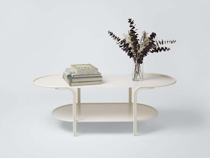 """""""I'm a big fan of Laun's furniture—think architectural curves and sultry shapes that work both indoors or out—and this coffee table is no exception. Inspired by L.A.'s Streamline Moderne architecture, the powder-coated steel piece is elegant and simple, while still being versatile. I could see it being ideal on a backyard patio or in the middle of my living room."""" —<a href=""""https://www.architecturaldigest.com/contributor/zoe-sessums?mbid=synd_yahoo_rss"""" rel=""""nofollow noopener"""" target=""""_blank"""" data-ylk=""""slk:Zoë Sessums"""" class=""""link rapid-noclick-resp"""">Zoë Sessums</a>, digital design writer $1900, 1stDibs. <a href=""""https://www.1stdibs.com/furniture/building-garden/garden-furniture/tiered-outdoor-coffee-table-matte-cream-stainless-steel-powdercoat-laun/id-f_24338612/"""" rel=""""nofollow noopener"""" target=""""_blank"""" data-ylk=""""slk:Get it now!"""" class=""""link rapid-noclick-resp"""">Get it now!</a>"""