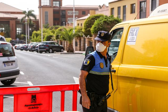 Police at the H10 Costa Adeje Palace Hotel in Tenerife, where more than 160 Britons are quarantined (Pacific Press/Sipa USA)