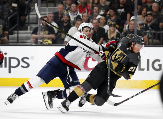 Washington Capitals right wing Tom Wilson, left, shoves down Vegas Golden Knights center Cody Eakin during the second period in Game 2 of the NHL hockey Stanley Cup Finals Wednesday, May 30, 2018, in Las Vegas. (AP Photo/John Locher)