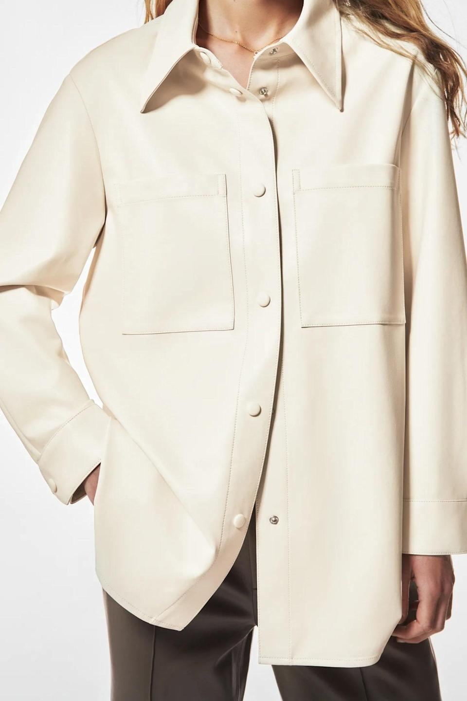 """For the love of leather, slip into this creamy number from Zara. We love it worn open over a <a href=""""https://www.glamour.com/gallery/best-t-shirts-for-women?mbid=synd_yahoo_rss"""" rel=""""nofollow noopener"""" target=""""_blank"""" data-ylk=""""slk:T-shirt"""" class=""""link rapid-noclick-resp"""">T-shirt</a> to put an edgy spin on <a href=""""https://www.glamour.com/gallery/35-fall-jackets-coats?mbid=synd_yahoo_rss"""" rel=""""nofollow noopener"""" target=""""_blank"""" data-ylk=""""slk:your fall layering system"""" class=""""link rapid-noclick-resp"""">your fall layering system</a>. $70, Zara. <a href=""""https://www.zara.com/us/en/faux-leather-oversized-shirt-p03811240.html?v1=119538314"""" rel=""""nofollow noopener"""" target=""""_blank"""" data-ylk=""""slk:Get it now!"""" class=""""link rapid-noclick-resp"""">Get it now!</a>"""