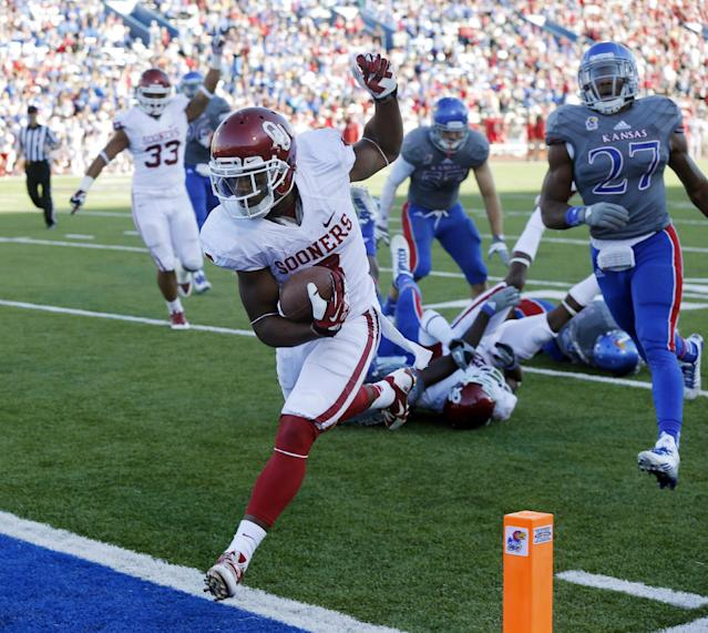 Oklahoma wide receiver Sterling Shepard (3) scores a touchdown past Kansas linebacker Victor Simmons (27) during the second half of an NCAA college football game in Lawrence, Kan., Saturday, Oct. 19, 2013. (AP Photo/Orlin Wagner)