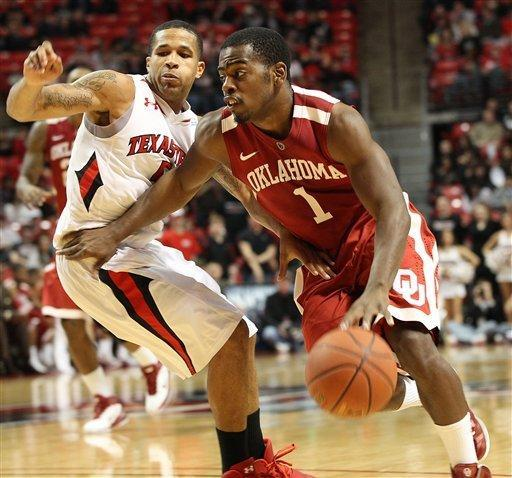 Oklahoma's Sam Grooms, right, drives against Texas Tech's Javarez Willis during their NCAA college basketball game in Lubbock, Texas, Saturday, Feb. 11, 2012. (AP Photo/Lubbock Avalanche-Journal, Zach Long) ALL LOCAL TV OUT