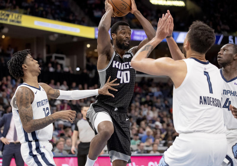 Sacramento Kings forward Harrison Barnes (40) looks to pass while defended by Memphis Grizzlies guard Ja Morant (12), forward Kyle Anderson (1) and center Gorge Dieng, right, during the first half of an NBA basketball game Friday, Feb. 28, 2020, in Memphis, Tenn. (AP Photo/Nikki Boertman)