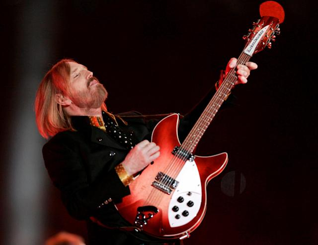 FILE PHOTO: Singer Tom Petty plays with his band 'The Heartbreakers' during halftime of the NFL's Super Bowl XLII football game between the New England Patriots and the New York Giants in Glendale, Arizona, U.S., February 3, 2008. REUTERS/Jeff Haynes/File Photo TPX IMAGES OF THE DAY