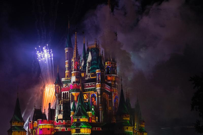 ORLANDO, FLORIDA, UNITED STATES - 2019/07/17: Purple and golden fireworks and strobe lights illuminating the Cinderella Castle in the Walt Disney's Magic Kingdom themed park. The famous place is one of the most attended attractions in the world. (Photo by Roberto Machado Noa/LightRocket via Getty Images)