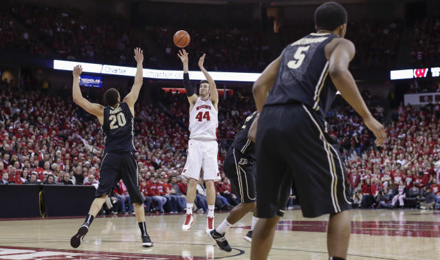 Wisconsin's Frank Kaminsky (44) shoots against Purude's A.J. Hammonds (20) during the second half of an NCAA college basketball game Wednesday, March 5, 2014, in Madison, Wis. Kaminsky had a game-high 20-points in Wisconsin's 76-70 win. (AP Photo/Andy Manis)