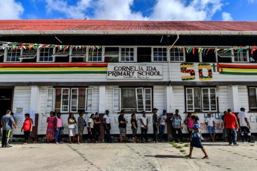 Guyanese citizens line up to vote in general elections in Leonora