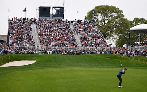 Brooks Koepka of the United States plays a third shot on the 18th hole - Credit: GETTY IMAGES