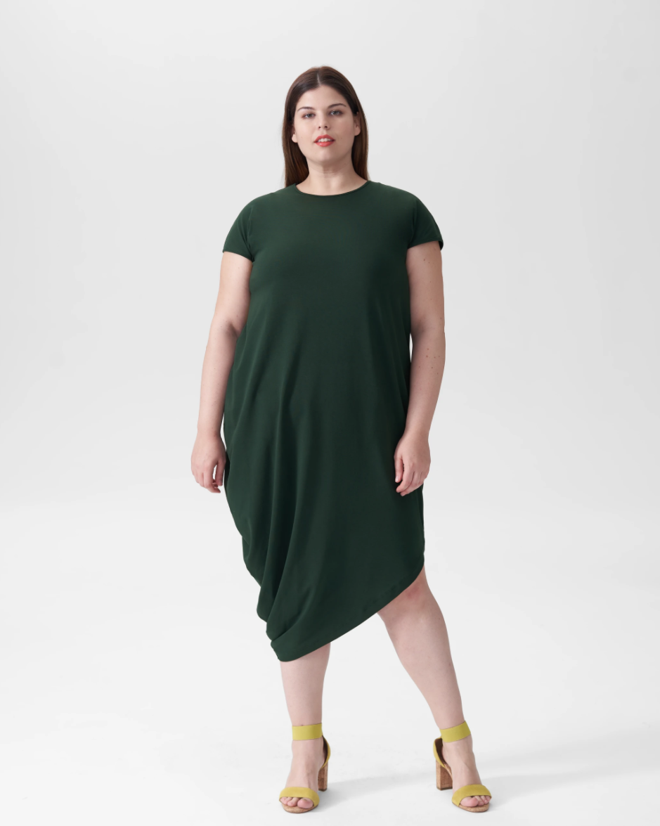 """<h2>Universal Standard Geneva Dress</h2><br><strong><em>The Sleeper<br></em></strong><br>Universal Standard's now-iconic Geneva Dress may look simple, but it's engineered to provide both comfort and supreme elegance. Listen to the reviewers: don't underestimate the power of tailored, expertly-draped Peruvian cotton.<br><br><strong>The Hype:</strong> 5 out of 5 stars; 59 reviews on UniversalStandard.com<br><br>""""I felt silly after buying this dress on a bit of an impulse, because I was worried I just spent over $100 on a long t-shirt, but after having it for a couple of weeks now I have no regrets. It's comfortable like a t-shirt or pajamas, but the tailoring and fabric quality are exceptional. I have worn it with tights and flats for the office, and I've worn it around the house on a day when I was feeling under the weather. It's easy to care for and the color is beautiful. I'm a size 22 and I bought the large, which fits perfectly."""" — Maggie S., UniversalStandard.com reviewer<br><br><em>Shop <strong><a href=""""http://universalstandard.com"""" rel=""""nofollow noopener"""" target=""""_blank"""" data-ylk=""""slk:Universal Standard"""" class=""""link rapid-noclick-resp"""">Universal Standard</a></strong></em><br><br><strong>Universal Standard</strong> Geneva Dress, $, available at <a href=""""https://go.skimresources.com/?id=30283X879131&url=https%3A%2F%2Fwww.universalstandard.com%2Fproducts%2Fgeneva-dress-forest-green"""" rel=""""nofollow noopener"""" target=""""_blank"""" data-ylk=""""slk:Universal Standard"""" class=""""link rapid-noclick-resp"""">Universal Standard</a>"""