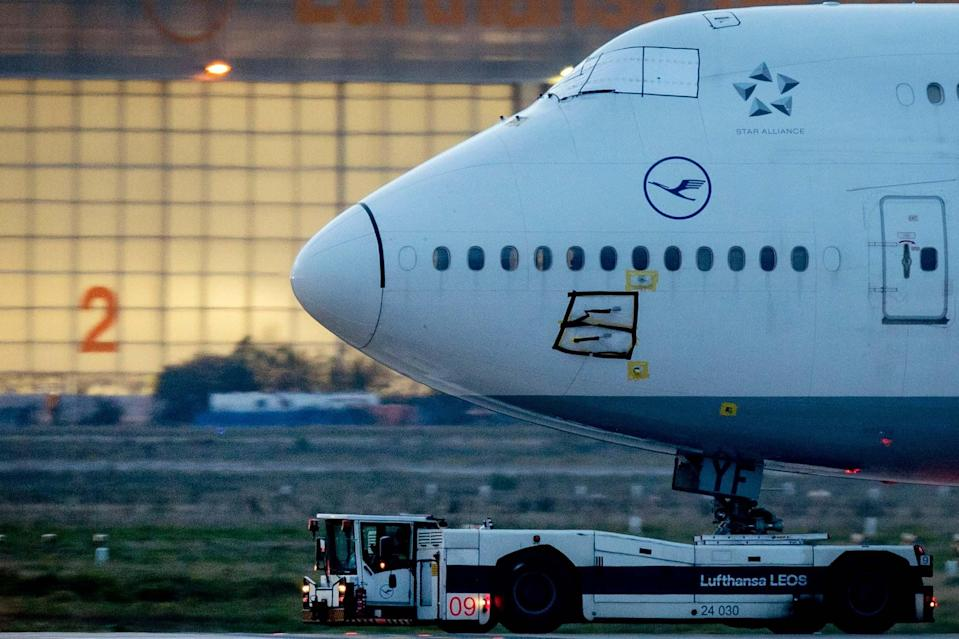 A Lufthansa Boeing 747 is pulled to a parking position at the airport in Frankfurt: AP