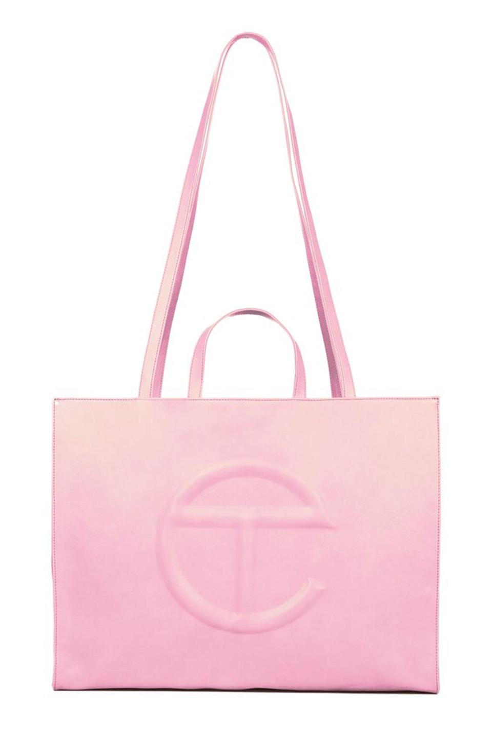 """<p>telfar.net</p><p><strong>$2020.00</strong></p><p><a href=""""https://shop.telfar.net/collections/bubblegum-pink-shopping-bags/products/large-bubblegum-pink-shopping-bag?variant=32457577300067"""" rel=""""nofollow noopener"""" target=""""_blank"""" data-ylk=""""slk:Shop Now"""" class=""""link rapid-noclick-resp"""">Shop Now</a></p><p>Unofficially dubbed the """"Bushwick Birkin,"""" the Telfar Shopping Bag is the most coveted bag of the year. The vegan tote bag, embossed with their iconic logo, is typically spotted on cool, underground, creative artists of New York. Because of its popularity, the only way to get a hold of one is to wait for a bag drop online, where bags sell out in minutes. Despite its scarcity, the black-owned, non-gendered fashion brand initially created the bag to be accessible for the community. The Large Shopping Bag is the ideal weekend and travel bag, but don't bother deciding on just one—you'll find an excuse to collect it in every size and colo</p>"""