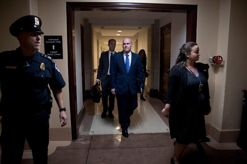 Michael McKinley, a former top aide to Secretary of State Mike Pompeo, leaves Capitol Hill in Washington, Oct. 16, 2019, after testifying before congressional lawmakers as part of the House impeachment inquiry into President Donald Trump.