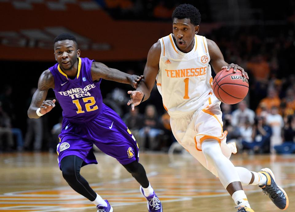 Tennessee guard Josh Richardson (1) drives past Tennessee Tech guard Mitchell Hill (12) during the first half of an NCAA college basketball game in Knoxville, Tenn. on Friday, Dec. 19, 2014. (AP Photo/Knoxville News Sentinel, Adam Lau)