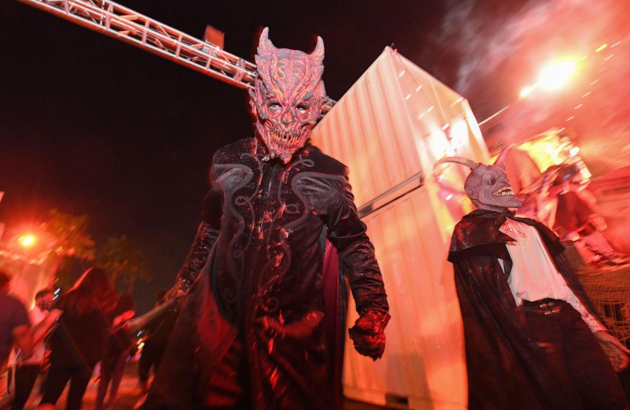A costumed actor walks around the park scaring visitors on the opening night of the Halloween Horror Nights at Universal Studios Hollywood, in Universal City, Calif., September 9 , 2021. (Valerie Macon/AFP via Getty Images)