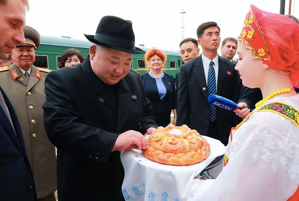 The North Korean leader received bread and salt upon his arrival at Khasan train station (AP)