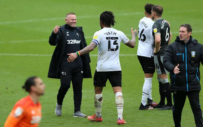 Derby survive after late Martyn Waghorn penalty keeps Wayne Rooney's men in the Championship - Nigel French/PA