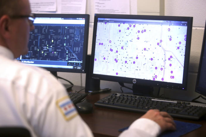 "FILE - In this Monday May 22, 2017 file photo, police monitor ShotSpotter and other crime detection programs at the Chicago Police Department 7th District's Strategic Decision Support Center, a high-tech intelligence center where crime data, surveillance and gunshot detection information is analyzed. In a Monday, May 3, 2021 court filing, community groups argue the gunshot detection system routinely reports gunshots where there are none, sending officers into predominantly Black and Latino neighborhoods for ""unnecessary and hostile"" encounters. (Michael Tercha/Chicago Tribune via AP)"
