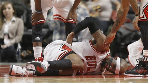Chicago Bulls shooting guard Richard Hamilton lies on the court during the first half of an NBA basketball game against the Indiana Pacers, Wednesday, Jan. 25, 2012,in Chicago. Hamilton recovered and continued to play. (AP Photo/Charles Rex Arbogast)