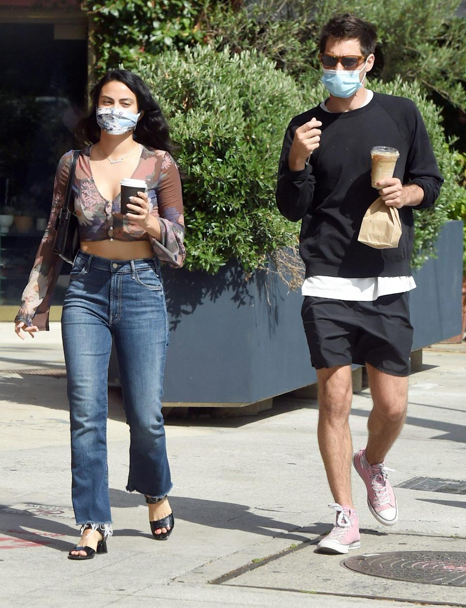 <p>Camila Mendes and boyfriend Grayson Vaughan take their coffees to-go while out in L.A. on Tuesday.</p>