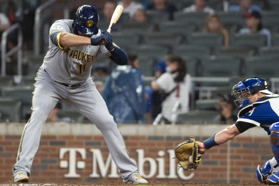 Milwaukee Brewers' Rowdy Tellez (11) avoids pitch during the sixth inning of a baseball game against the Atlanta Braves, Friday, July 30, 2021, in Atlanta. (AP Photo/Hakim Wright Sr.)