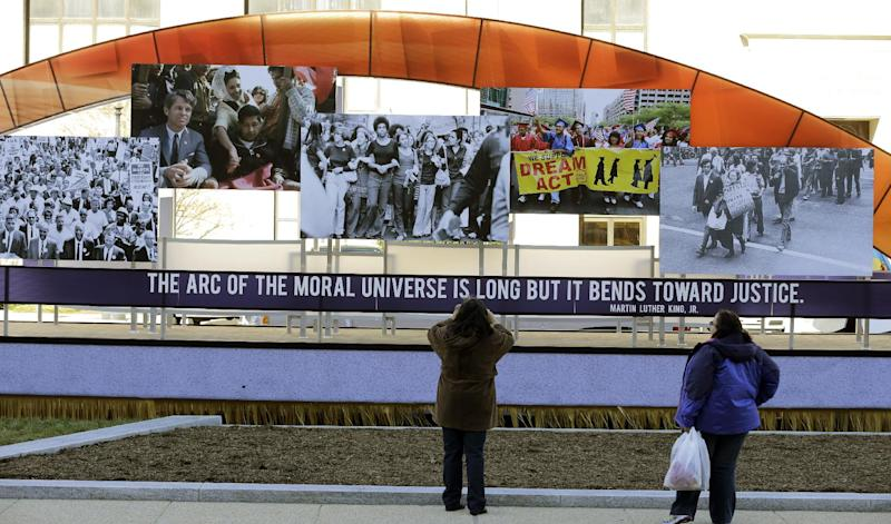 A person takes a picture of the civil rights movement float prepared for the 57th Presidential Inaugural Parade, Sunday, Jan. 20, 2013 in Washington. Thousands are planning to march in the 57th Presidential Inauguration parade after the ceremonial swearing-in of President Barack Obama on Monday. (AP Photo/Alex Brandon)