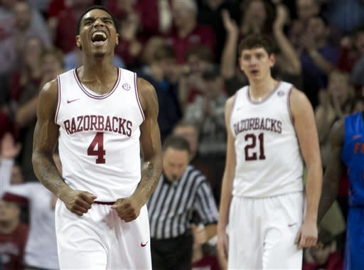 Arkansas' Coty Clarke (4) celebrates after a Florida foul during the second half an NCAA college basketball game in Fayetteville, Ark., Tuesday, Feb. 5, 2013. (AP Photo/Gareth Patterson)