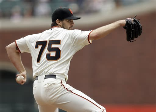 San Francisco Giants starting pitcher Barry Zito throws to the Philadelphia Phillies during the first inning of a baseball game Wednesday, May 8, 2013, in San Francisco. (AP Photo/Marcio Jose Sanchez)